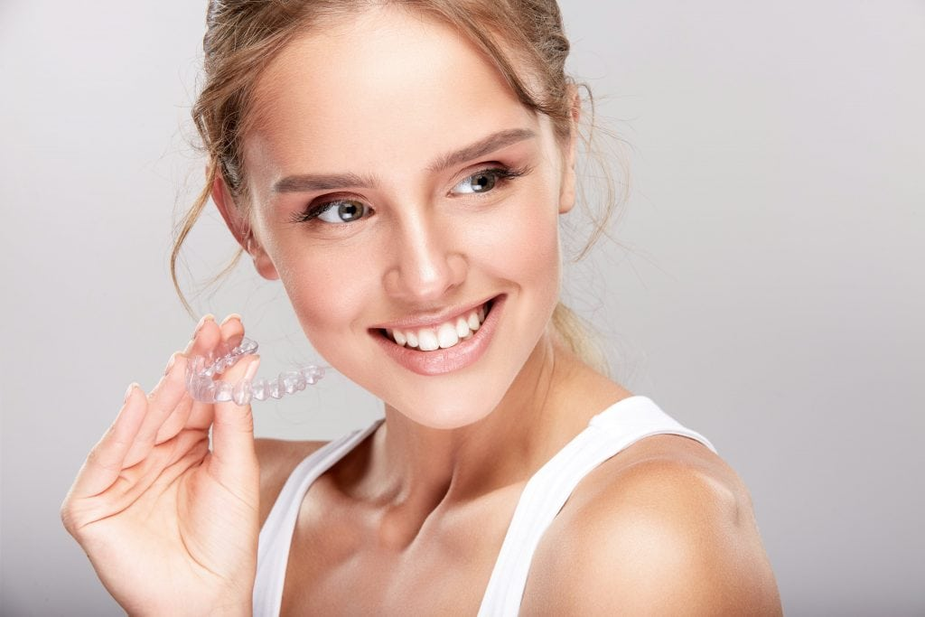 lady wearing invisalign clear aligner